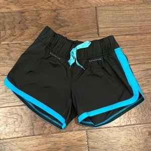 Size 8 Lululemon Black/Turquoise Run Motion Shorts